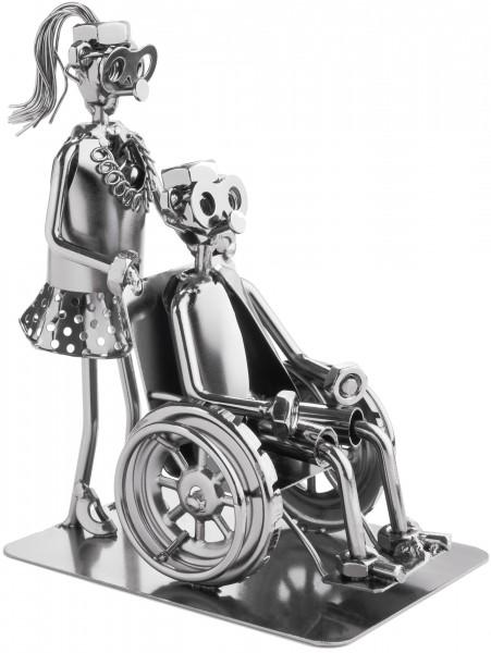 Schraubenmännchen Pflegerin mit Rollstuhlfahrer - Metallfigur Handarbeit